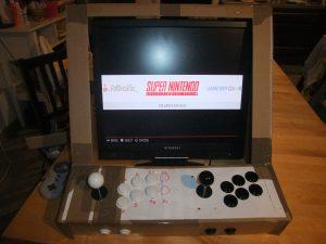 Photo du gabarit carton avec système boutons et Joysticks en place